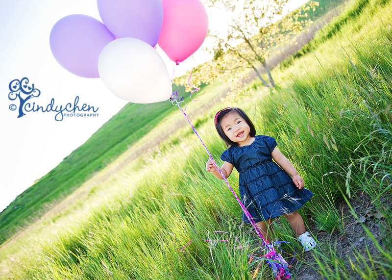fun with balloons in a green field