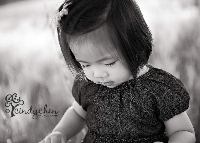 black and white photography of a little girl with lovely lashes