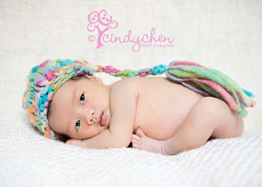 newborn baby in sherbet stocking cap