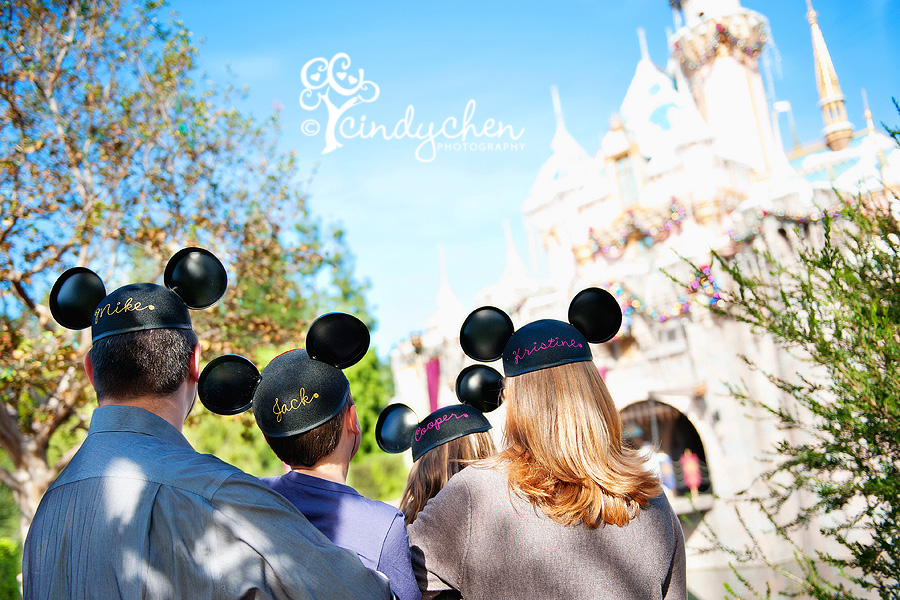 family with mouse ears at disneyland california